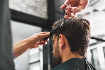 Hairdresser undergoing hairdo at salon Wall mural