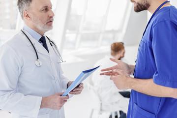 Smart doctors discussing health of patient