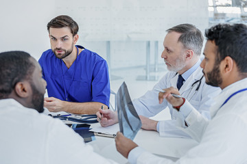 Smart doctors gathering council at clinic