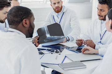 Confident doctors having conversation at hospital