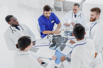 Professional doctors having serious conversation