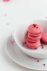 French Macarons Stacked in White Bowl on White Table