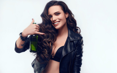 Young sexy girl with long hair in leather jacket with beer