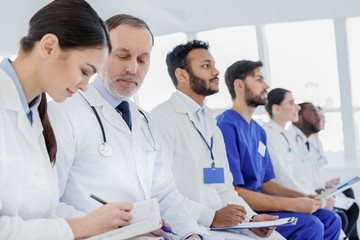 Professional doctors learning more about disease