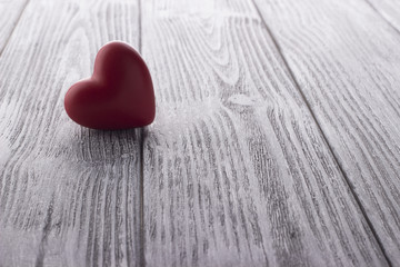 Red Heart on the white painted wooden background