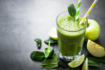 Healthy green spinach smoothie in glass