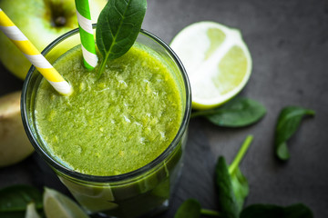 Healthy green spinach smoothie in glass. Clean eating and healthy food.