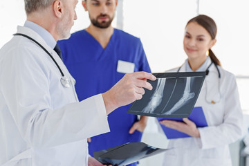 Smart doctors discussing x-ray photo
