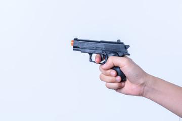 hand holding toy  black gun plastic for children on white backgr