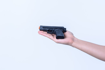 hand holding toy  black gun plastic for children on white backgr