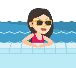 Smiling young woman in swimming pool.