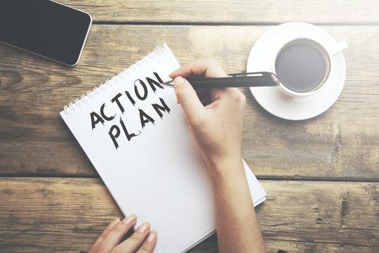 Woman write action plan text