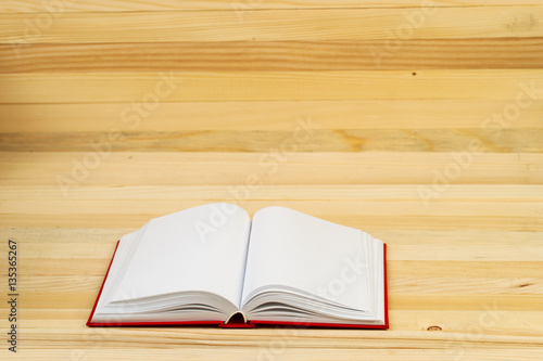 Open book on wooden table fotolia for When did table 52 open