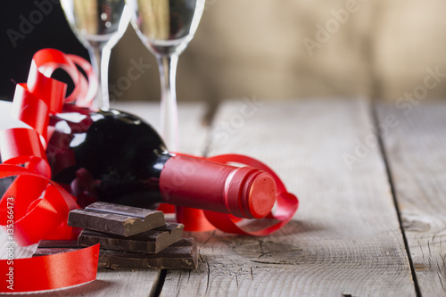 Chocolate And Bottle Of Red Vine With Red Ribbon Valentines Day
