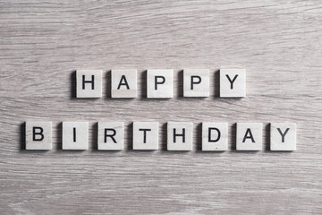wooden elements with letter collected to word happy birthday