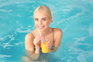 Beautiful girl drinking juice in jacuzzi