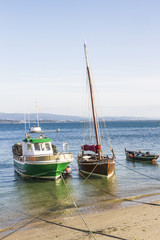 Boats moored on the beach