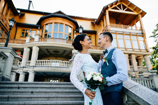 Wedding couple smiling on mansion background