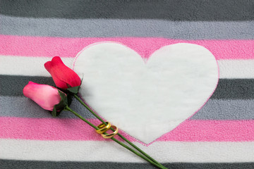 The pink fabric with heart and rose flower in concept valentines day. / Pattern on cotton fabric, heart & copy space abstract background.