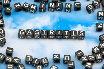 The word Gastritis on the sky background