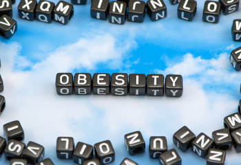 The word Obesity on the sky background