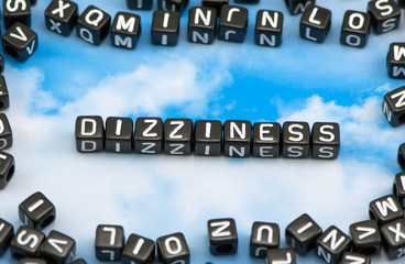 The word Dizziness on the sky background