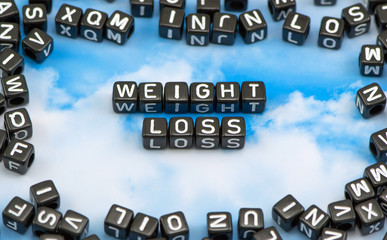 The word Weight Loss on the sky background