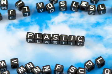 The word plastic on the sky background