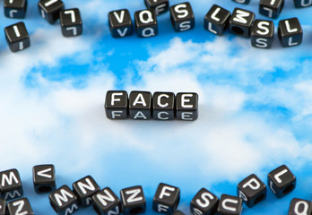 The word Face on the sky background