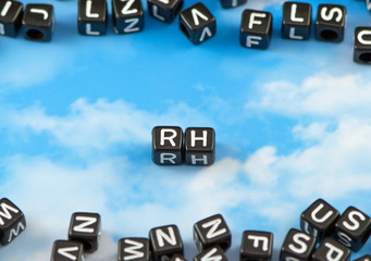 The word Rh on the sky background