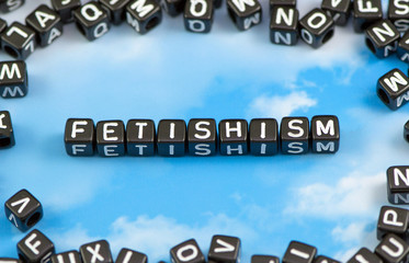 The word Fetishism on the sky background
