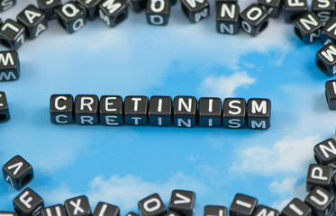 The word Cretinism on the sky background
