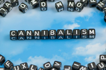 The word Cannibalism on the sky background