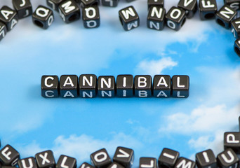 The word Cannibal on the sky background