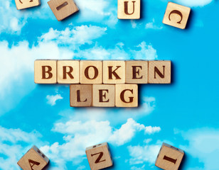 The word Broken leg on the sky background