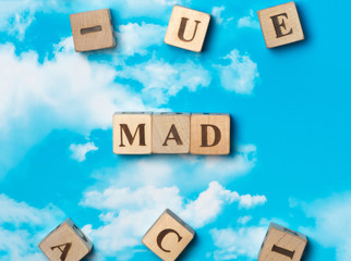 The word mad on the sky background