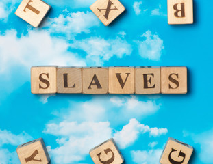 The word slaves on the sky background