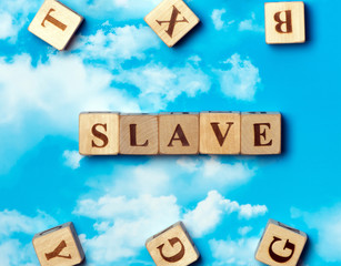 The word slave on the sky background