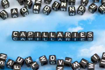 The word Capillaries on the sky background