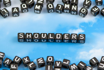 The word shoulders on the sky background