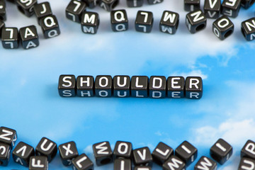 The word shoulder on the sky background