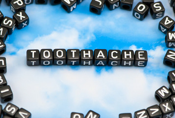 The word Toothache on the sky background