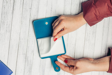 leafing through files in the business card holder, hands, red nails