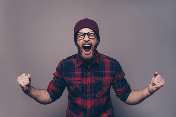 Depressed angry hipster bearded man yelling and screaming