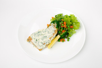 grilled fish with vegetables on a white background
