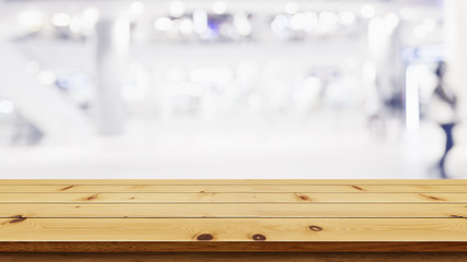 Empty top of wooden table with blur shopping mall background.