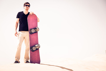 Tourist Sand Skiing In The Desert