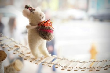 cute little stuffed animal hamster on rope bridge