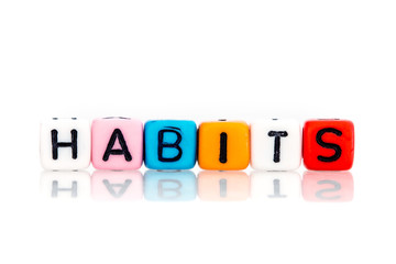colorful word cube of habits on white background