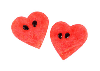 Two hearts made of red watermelon fruit isolated on white background, Valentines collection.